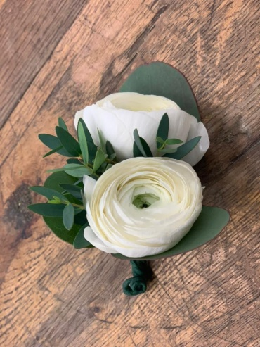 Double white ranunculus boutonniere