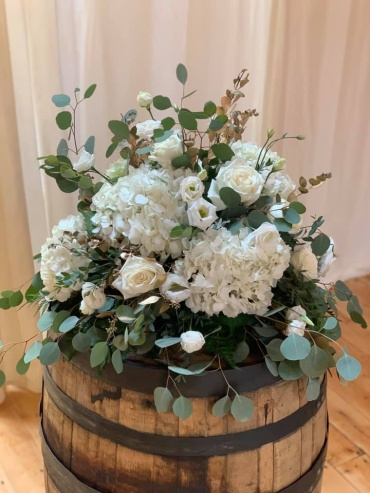 White Arrangements on Wine Barrels