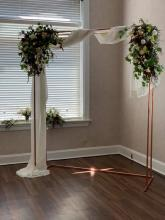 Iron arch floral swags